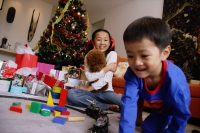 Children opening gifts on Christmas - Alex Microstock02