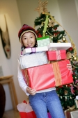 Girl holding pile of Christmas gifts - Alex Microstock02