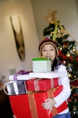 Girl carrying wrapped gift boxes - Alex Microstock02