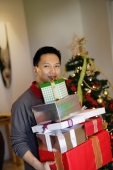Man carrying pile of gifts - Alex Microstock02