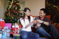 Couple giving each other Christmas gifts - Alex Microstock02
