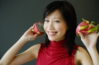 Woman holding dragon fruit - Alex Microstock02