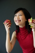 Woman holding cut dragon fruit - Alex Microstock02