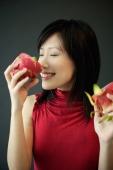 Woman smelling dragon fruit - Alex Microstock02