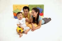 Young parents with one child, portrait - blueduck