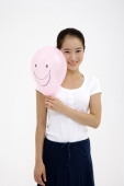 Woman holding pink balloon, smiling - blueduck