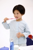 Young girl brushing her teeth - blueduck