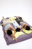 Family with one child, sleeping on bed - blueduck
