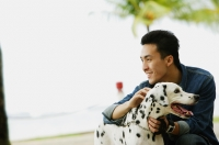 Man petting his Dalmatian dog - Alex Microstock02