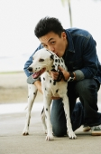 Man with Dalmatian dog, smiling at camera - Alex Microstock02