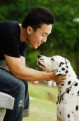 Man with his Dalmatian dog, side view - Alex Microstock02