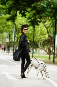 Woman dressed in black, walking dog - Alex Microstock02