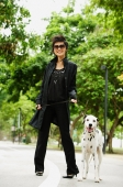 Woman dressed in black, with Dalmatian - Alex Microstock02