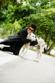 Woman embracing Dalmatian - Alex Microstock02