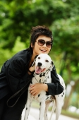 Woman with sunglasses embracing Dalmatian - Alex Microstock02
