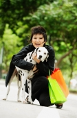 Woman with shopping bags embracing Dalmatian - Alex Microstock02