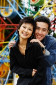 Couple at playground, smiling at camera - Alex Microstock02