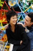 Couple at playground, laughing - Alex Microstock02