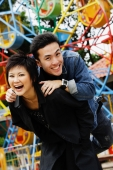 Couple at playground, looking at camera, smiling - Alex Microstock02