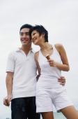 Couple standing, embracing, holding ice cream cones - Alex Microstock02