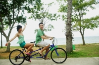 Couple cycling on tandem bicycle - Alex Microstock02
