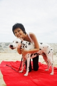 Woman with Dalmatian on beach - Alex Microstock02