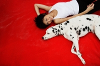 Woman with Dalmatian on red blanket - Alex Microstock02