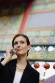 Businesswoman using mobile phone, portrait - Alex Microstock02