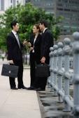 Business people talking - Alex Mares-Manton