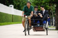 Businessmen riding in trishaw - Alex Microstock02