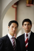 Businessmen looking at camera - Alex Mares-Manton