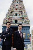 Businessmen standing in front of Hindu temple - Alex Microstock02