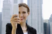 Businesswoman using mobile phone, photo messaging - Alex Microstock02