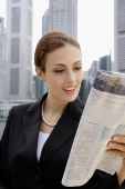 Businesswoman reading newspaper - Alex Microstock02