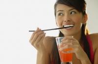 Woman biting straw, holding drink - Alex Microstock02