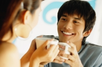 Couple having coffee, looking at each other - Alex Microstock02