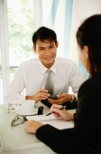 Business people having a discussion over coffee - Alex Microstock02