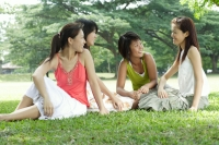 Young women sitting in park - Alex Microstock02