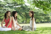 Young women in park, sitting on grass - Alex Microstock02