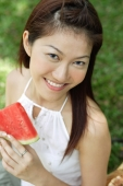 Woman with slice of watermelon, smiling at camera - Alex Microstock02