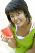 Young woman with slice of watermelon, smiling at camera - Alex Microstock02