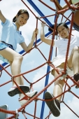 Young women climbing ropes at playground, smiling at camera - Alex Microstock02