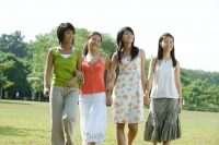 Young women walking side by side in park - Wang Leng