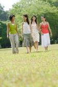 Four young women walking side by side in park - Wang Leng