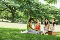 Young women having picnic, smiling at camera - Alex Microstock02