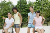 Young women in playground, smiling at camera - Alex Microstock02