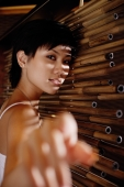 Young woman next to bamboo screen - Alex Microstock02