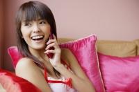Young woman using mobile phone - Yukmin