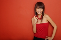 Young woman in red tube top applying perfume - Yukmin