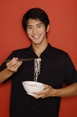 Man holding bowl of noodles - Yukmin